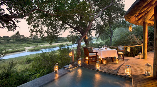 Suite's private deck and plunge pool with view of the river at Dulini River Lodge located in the Big 5 Sabi Sand Private Game Reserve