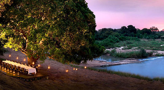 Dining near the river at Dulini River Lodge in the Big 5 Sabi Sand Private Game Reserve located in South Africa