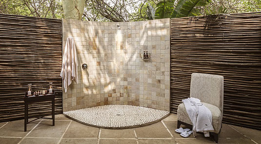 Executive Suites bathroom bath outdoor shower Luxury Accommodation Savanna Private Game Reserve Sabi Sands Reserve Accommodation bookings